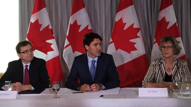 primejustin-trudeau-addresses-a-room-full-of-academics-politicians-and-stakeholders-in-a