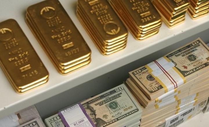 gold-bars-and-us-dollar-bills