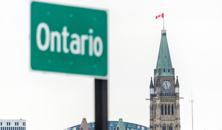 Ontario Road Sign with Peace Tower of the Canadian Parliament in Canada