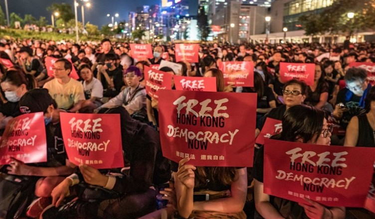 Hong Kong police arrest 6 protesters
